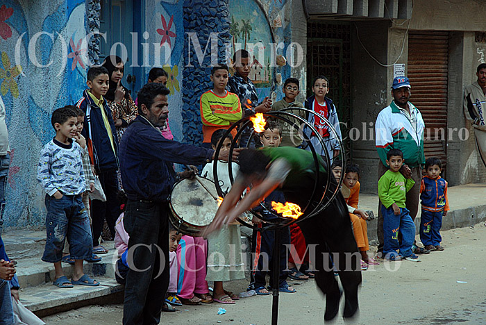 Street performers entertain children in Abu Qir's backstreets