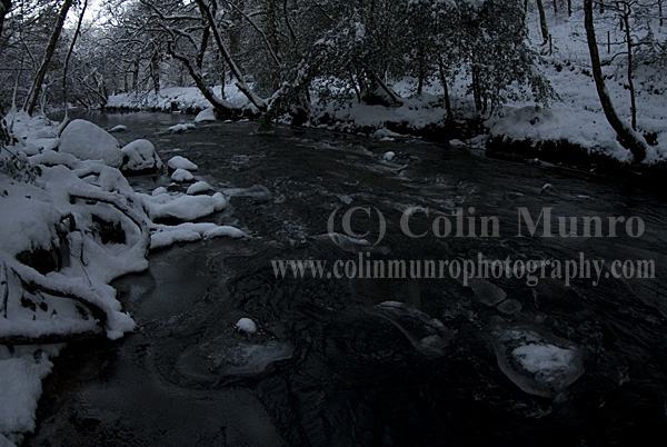 River Teign partially frozen, Dunsford Wood, South Devon, UK.
