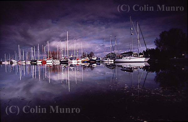 Yachts reflected on the calm waters of Exeter Canal on a winter's day. Image MBI000775.