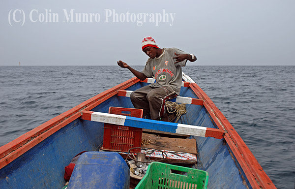 M'bour, Senegal. Fifteen miles offshore a Senegalese fishermen hand lines for fish over a sand bank. Image MBI000908.