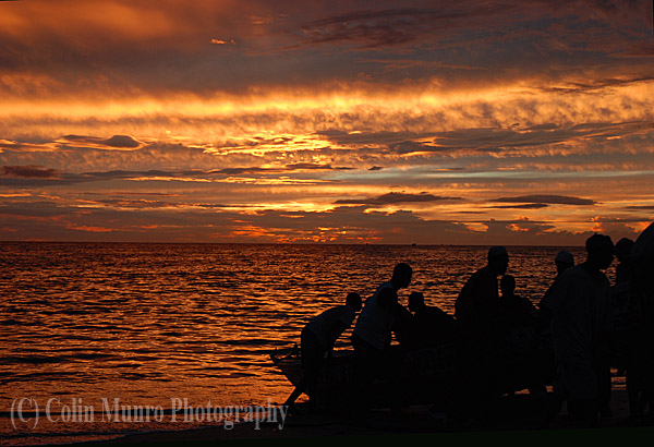 Pirogue fishermen at sunset, Senegal, West Africa Image. MBI000914