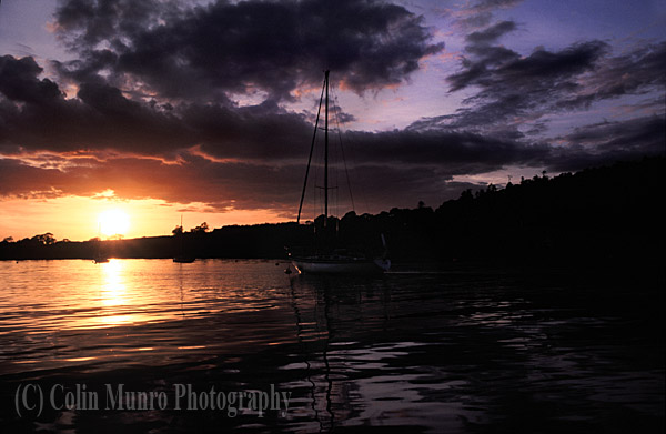Leaving harbour at sunset. Crosshaven, County Cork, Ireland. Colin Munro Photography. Image No. MBI000943