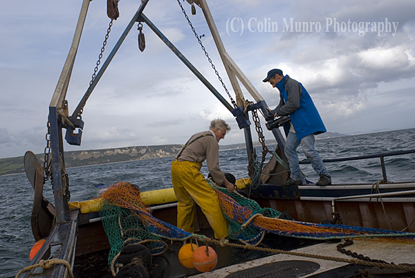 Filming the trawl net being deployed