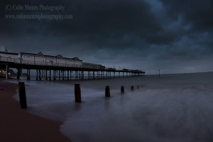 Heavy rain clouds above Teignmouth Pier, Teignmouth, Devon, England, UK.