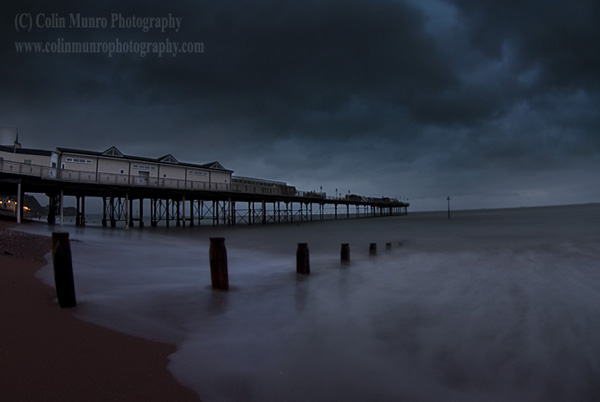 Heavy rain clouds above Teignmouth Pier, Teignmouth, Devon, England, UK.