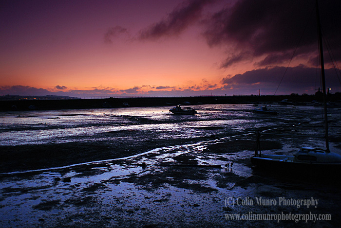 Sunrise over Cockwood Harbour at low tide, Exe Estuary, Devon.