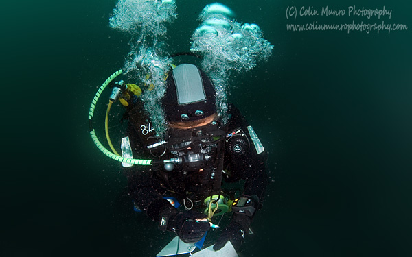 Professional diver ascending from depth. Colin Munro Photography