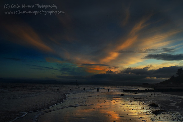 Sunset reflecting on wet sand, Exmouth Beach, Devon. Colin Munro Photography. www.colinmunrophotography.com