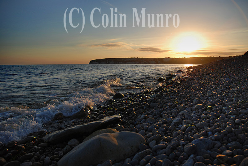By creating shadows and so releif, the low lighting that occurs during the Golden Hour enhances the three dimensional appearance of features such as pebble beaches.  Sunset, Axmouth pebble beach, beneath Haven Cliff.