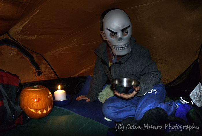 Tinned curry by candlelight. Hallowe'en in a two-man tent, on a very wet night in Glen Nevis. Colin Munro Photography
