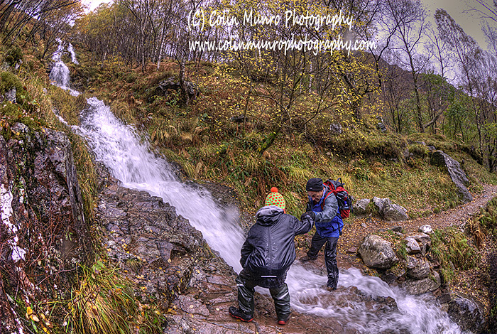 Helping Calum (or Calum helping me?) ford a mountain stream in Glen Nevis. Colin Munro Photography