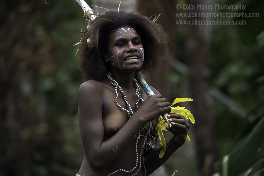 A girl dances during a traditional dance at a forest village, Malekula Island, Vanuatu.. © Colin Munro Photography