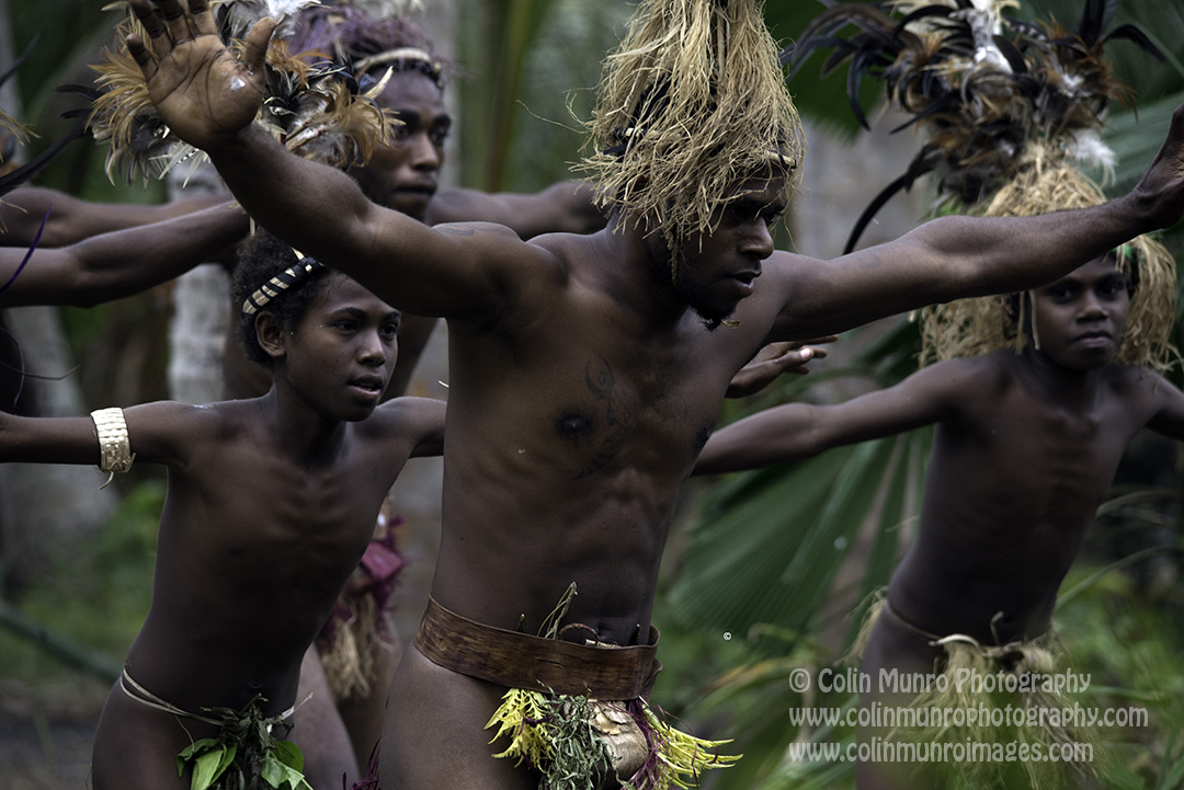 Men perform a traditional dance at a forest village, Malekula Island, Vanuatu. © Colin Munro Photography