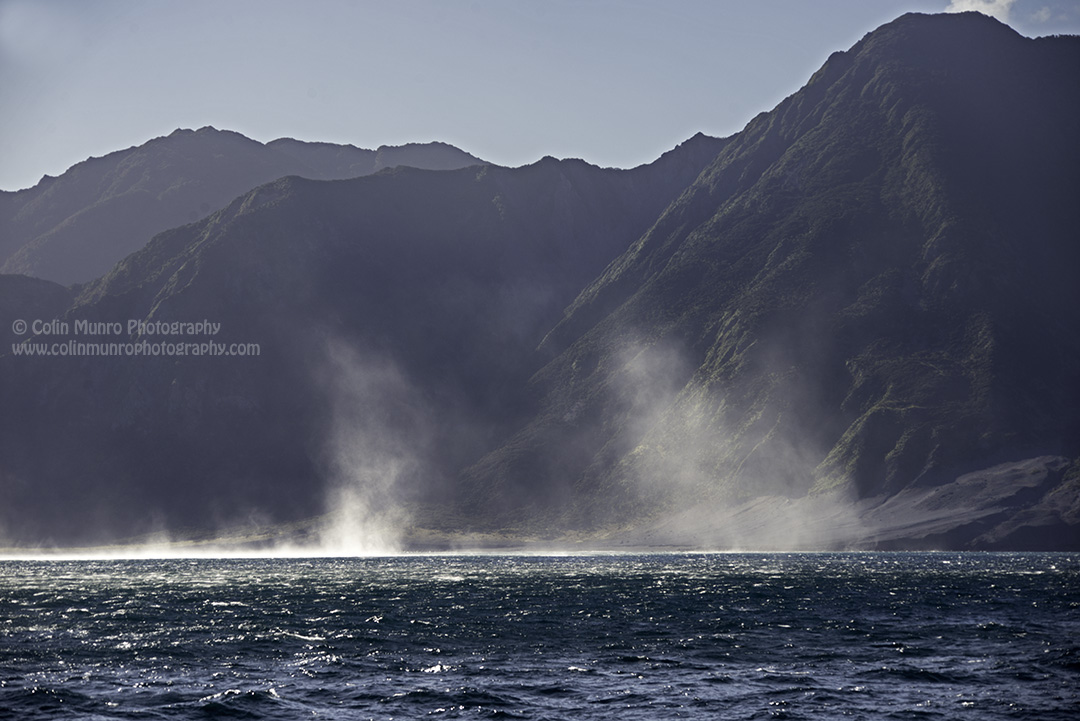 Fierce winds colliding with the steep-sided hills of Cape Palliser force sea spray over 50  metres into the air.