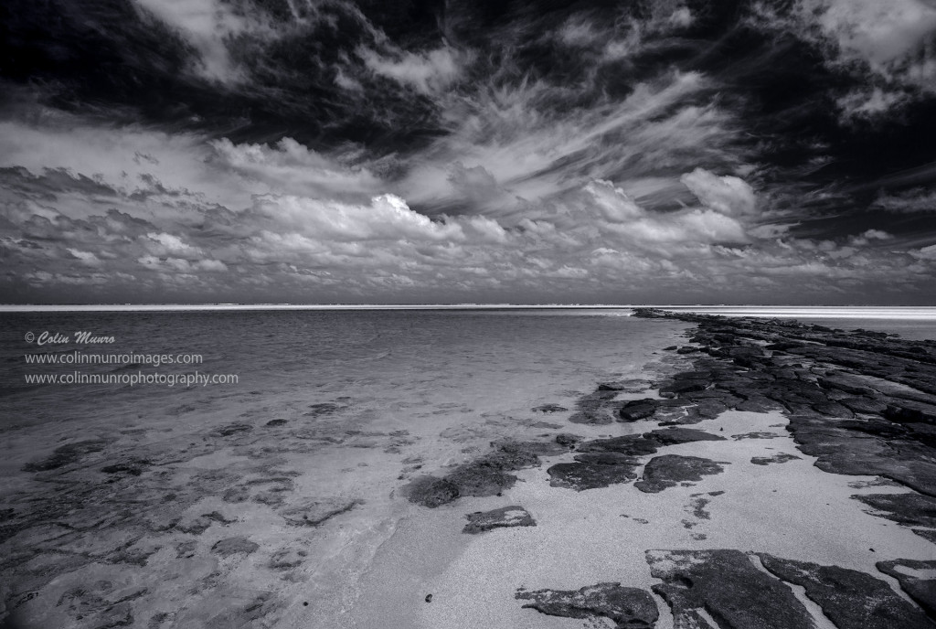 A black and white edit of beach and skyline, One-foot-Island, Aitutaki, Cook Islands, Polynesia. Colin Munro Photography © Colin Munro