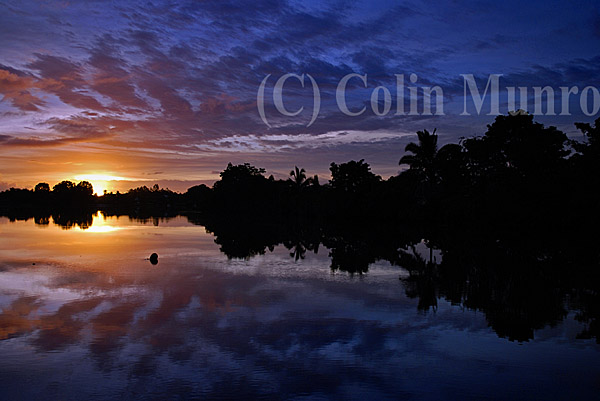 Sunrise and reflections, Navua river near the mouth at Beqa Lagoon, Viti Levu, Fiji.MBI000584