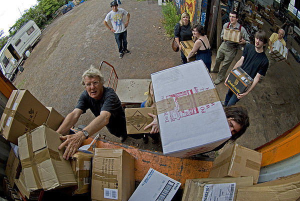 Book-Cycle volunteers loading boxes of books into a container truck at their warehouse in Exeter, Devon. Colin Munro Photography. Image No. MBI000944.