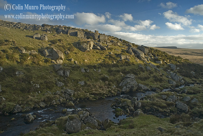 The boulder-strewn steep sided valley of the East Dart River above Two Bridges, Dartmoor National Park, Devon. Colin Munro Photography