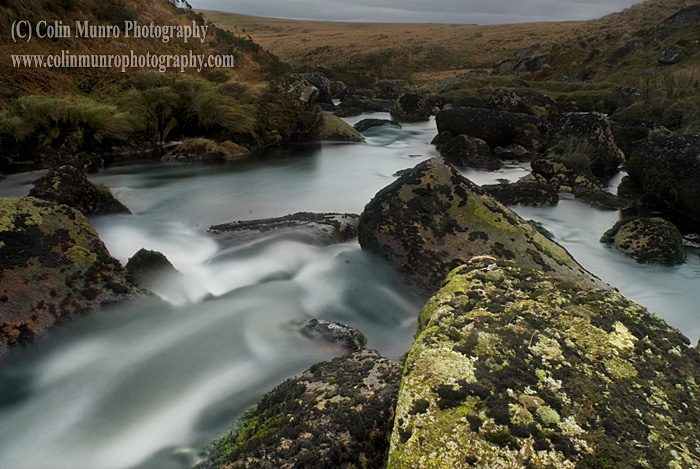 Boulders and small waterfalls on the East Dart River, high on Dartmoor above Two Bridges.  Dartmoor National Park Colin Munro Photography