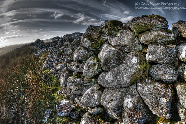 Lichen covered granite boulders of a dry stone wall. Dartmoor Devon. Colin Munro Photography. Fine Art prints