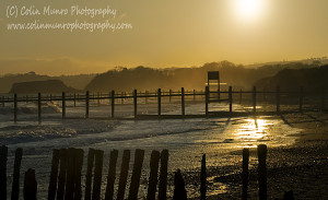 Low winter sun and breaking waves on Dawlish Warren beach, Exe Estuary, South Devon, UK. Colin Munro Photography www.colinmunrophotography.com
