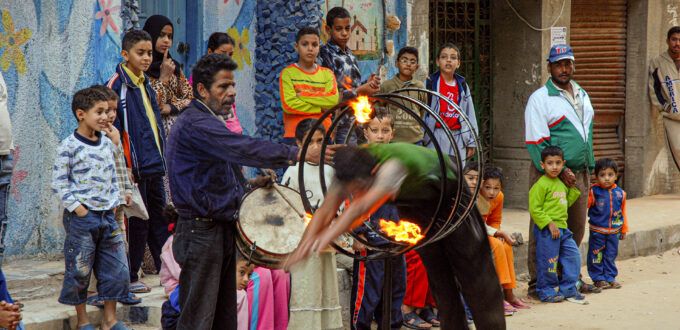 Street performers in the backstreets of Abu Qir seaport, Nile Delta, Egypt. www.colinmunrophotography.com