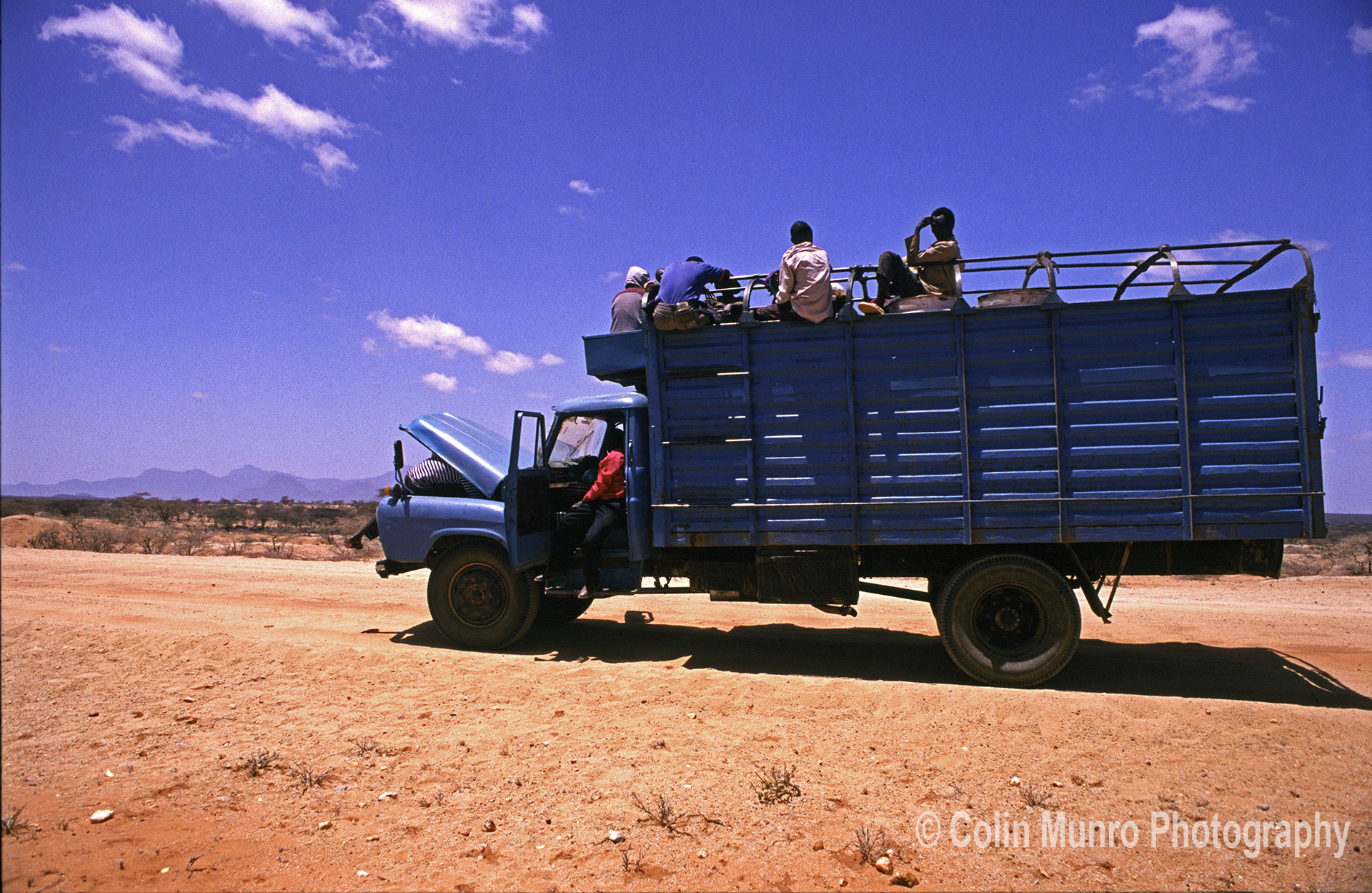 A truck carrying food aid to Marsabit and Turkana, 1980s, breaks down. www.colinmunrophotography.com